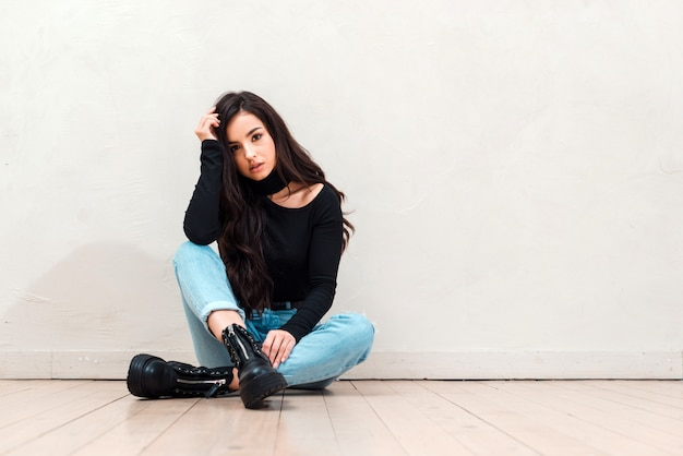 Very attractive girl sitting on the floor