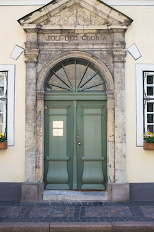 Very beautiful green old doors in the old city of riga in latvia.