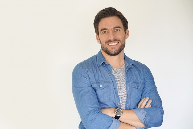 Very handsome casual man smiling and standing