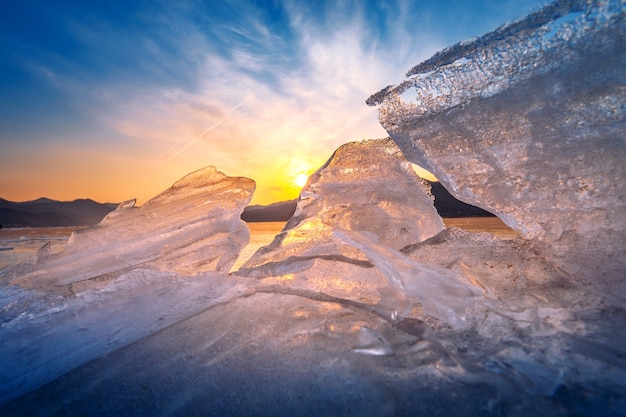 Very large and beautiful chunk of ice at sunrise in winter