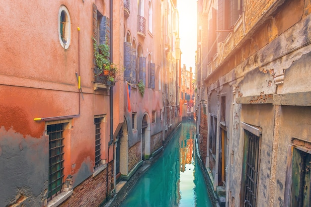 Very narrow street and canal in venice.
