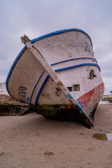 A very old boat on the sand