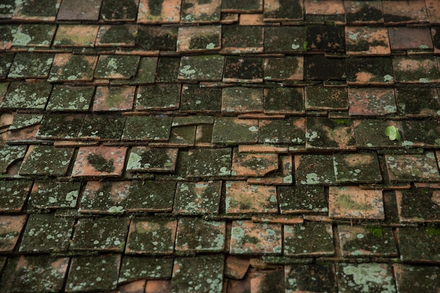 Very old dirty roof tile of thai asian temple roof style architecture pattern background