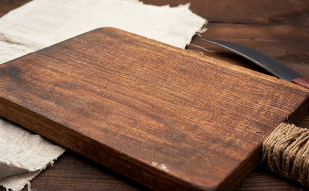 Very old empty wooden rectangular cutting board and knife