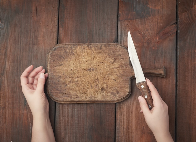 Very old empty wooden rectangular cutting board and sharp knife