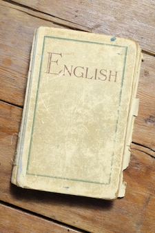 Very old english textbook on vintage wooden table
