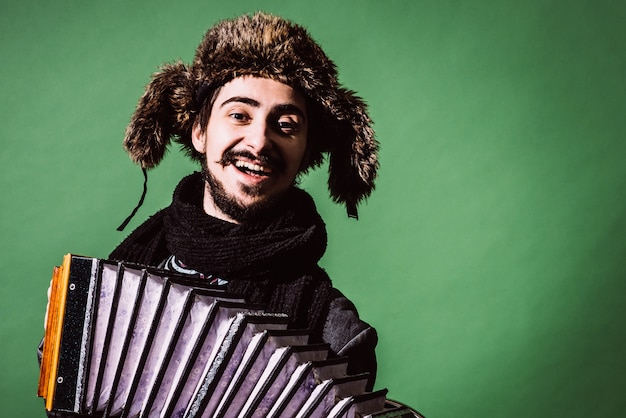 A very positive man with an accordion posing
