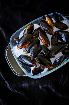 Very tasty and fresh mussels on ice cubes