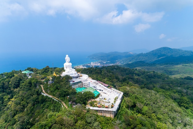 Vesak day background concept of big buddha over high mountain in phuket thailand aerial view drone shot.