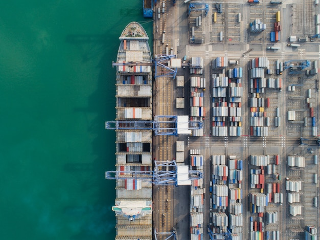 Vessel and container box in sea port from top view