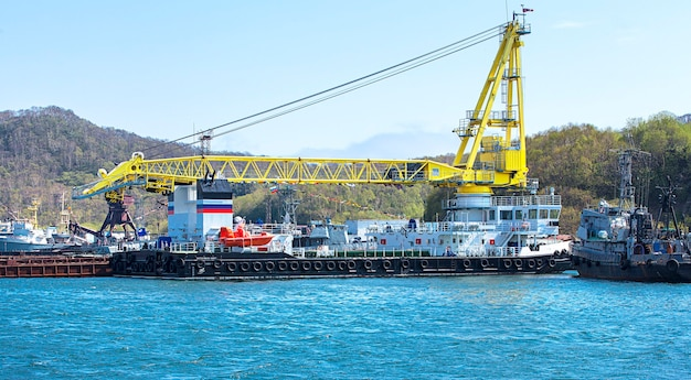 Vessel with a crane at the port in kamchatka
