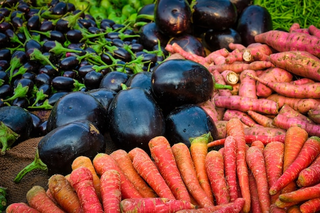 Vetegables carrots and aubergines in vegetable market in india