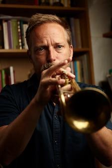 Veteran musician playing the trumpet