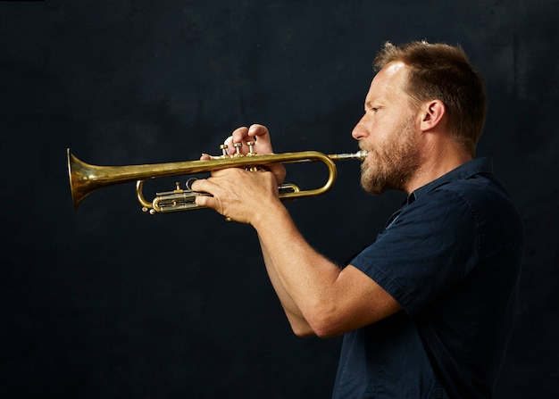 Veteran musician playing the trumpet