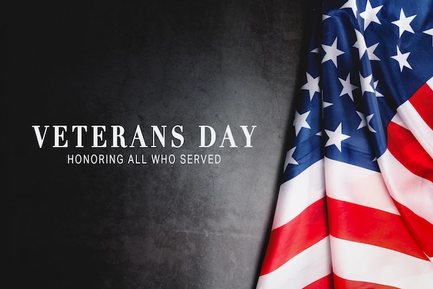 Veterans day. honoring all who served. american flag on gray background with copy space.
