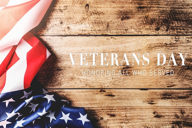 Veterans day. honoring all who served. american flag on wooden background