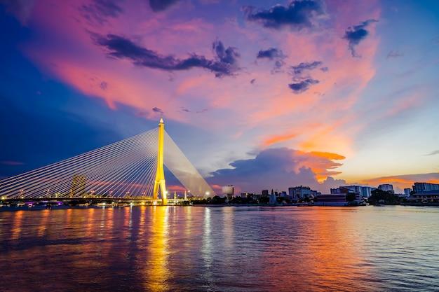 Vibrance and saturated twilight of rama 8 bridge, the famous landmark in bangkok, thailand Premium Photo