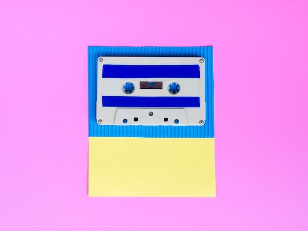 Vibrant cassette tape on bright wallpaper