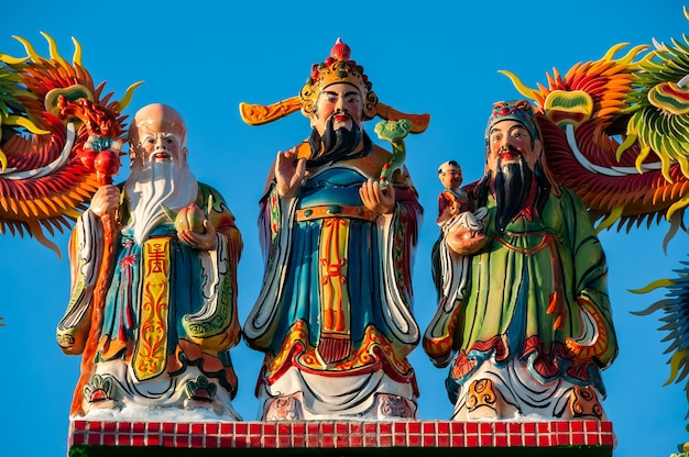 Vibrant colored statues of the three stellar gods of happiness and longevity fu lu sho