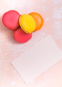 Vibrant cupcake and torn white paper on grunge background