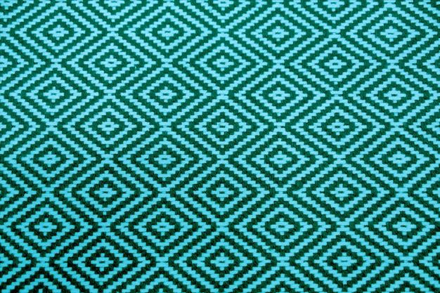 Vibrant and deep turquoise blue colored ethnic seamless pattern fabric for background