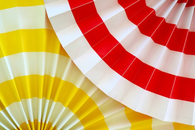 Vibrant yellow and red pleated paper decoration