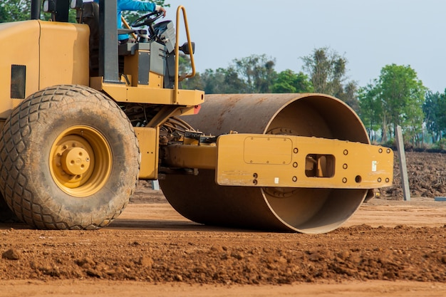 Vibratory roller compactor working on new road construction site