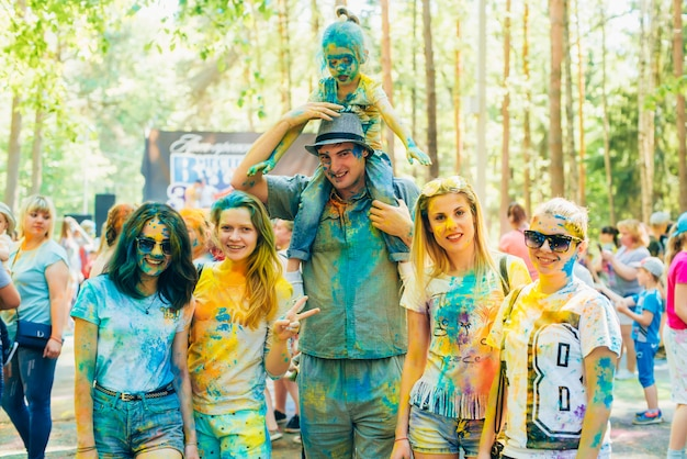 Vichuga, russia - june 17, 2018: festival of colors holi. group of happy people in paint