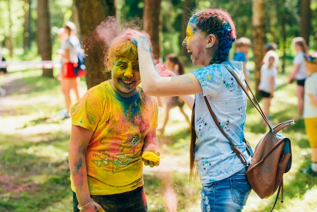 Vichuga, russia - june 17, 2018: festival of colors holi. happy joyful children