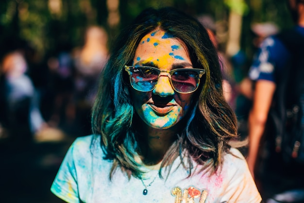 Vichuga, russia - june 17, 2018: festival of colors holi. portrait of a young happy girl