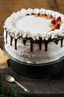 Victoria cake with raspberry, cranberries, mint, red currant. dessert. black forest cake.