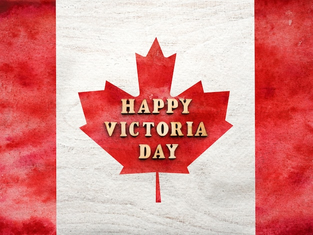 Victoria day lettering on the background of the canadian flag