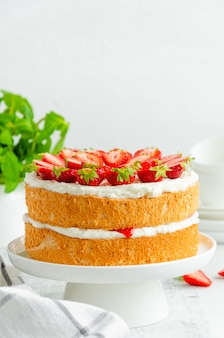 Victoria sponge cake with strawberry jam and whipped cream
