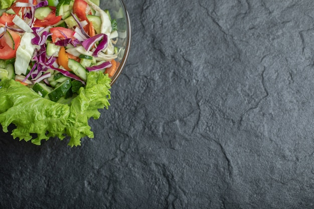 Vide angle organic healthy salad on black background. high quality photo