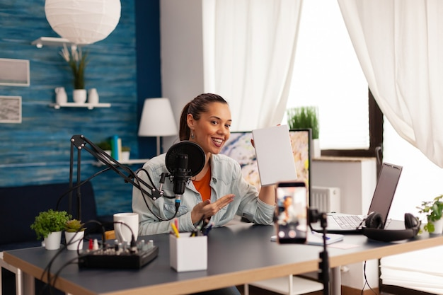 Video blogger recording talk show in home studio podcast using modern equipment. creative content creator influencer vlogger making online series with giveaway for audience .