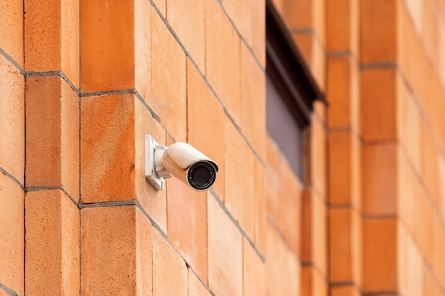 Video camera security system on the wall of the building.