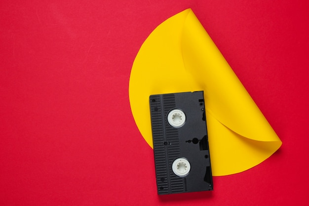 Video cassette tape on red yellow creative studio