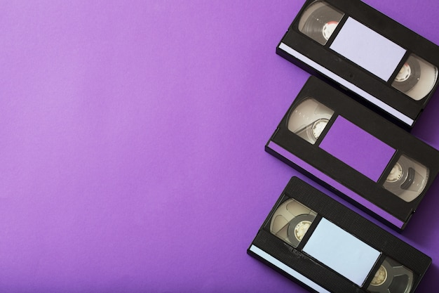 Video cassette on violet surface.