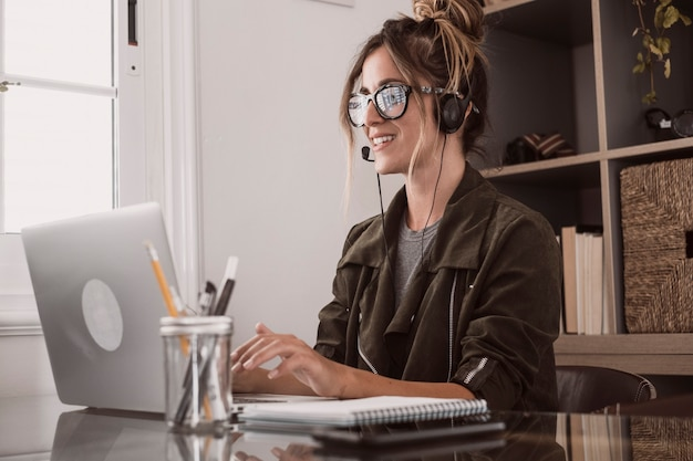 Video conference call in online smart working remote work job home office activity with pretty middle age woman enjoying online modern technology and internet connection to be free