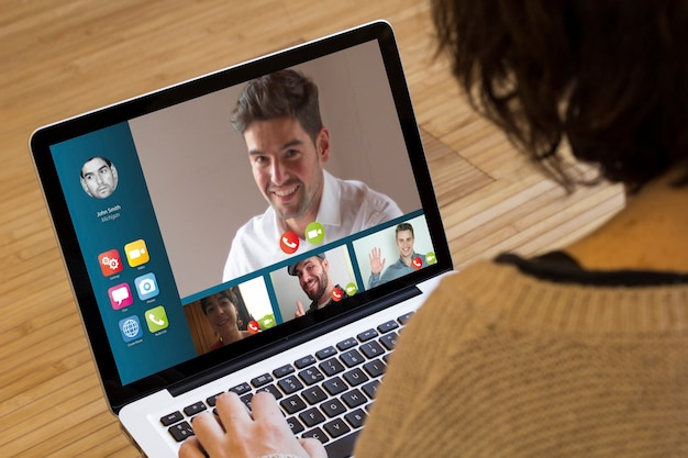 Video conference on a laptop screen.