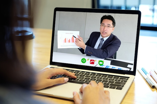 Video conference, work from home, businessman making video call to employee with virtual web