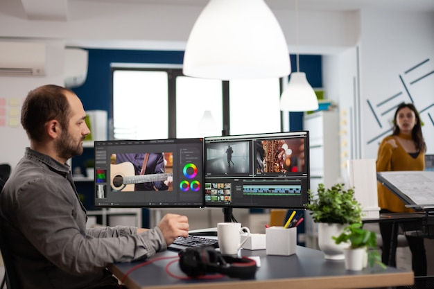 Video editor man editing movie project working in start up creativity multimedia agency