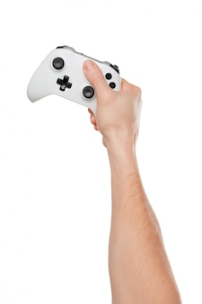 Video game console controller in gamer hands isolated