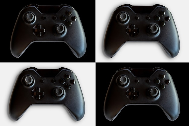 ビデオゲームコントローラーとゲームコントローラー。黒と白の背景。セレクティブフォーカス。