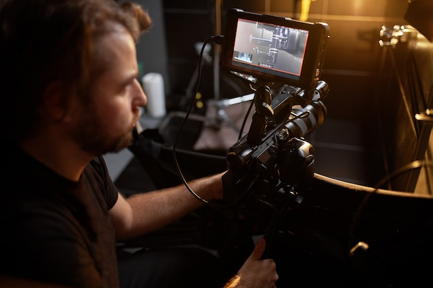 Video production backstage. behind the scenes of creating video content, a professional team of cameramen with a director filming commercial ads. video content creation, video creation industry.