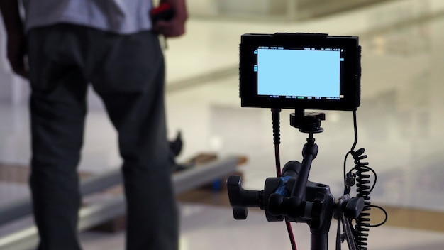 Behind video production digital view screen monitor from movie shooting camera in the studio.
