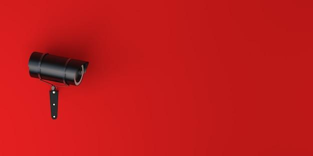赤い背景の上のビデオ監視カメラの背景。バナー。 3dイラスト。