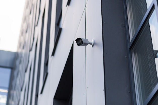 A video surveillance camera is located in a modern office center