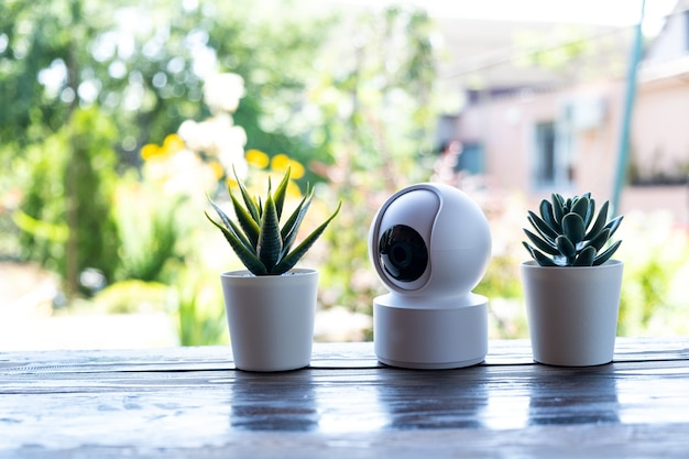 Video surveillance equipment on the table. compact security camera for outdoor or private home security.