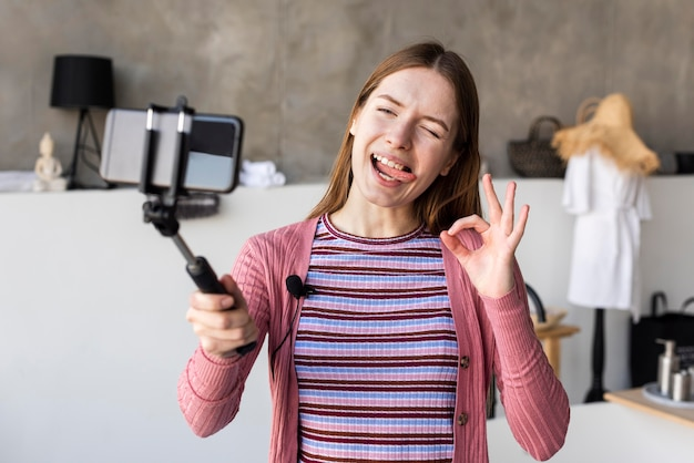 Videoblogger recording from home